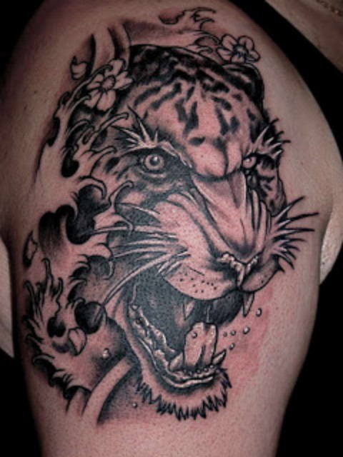 3D Waves And Tiger Scream Tattoos On Shoulder