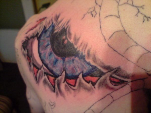 3D Wicked Eye Tattoo On Backbody