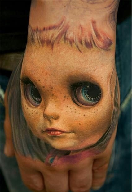 realistic-3d-doll-face-tattoo-on-hand