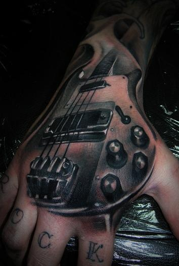 realistic-3d-guitar-tattoo-on-hand
