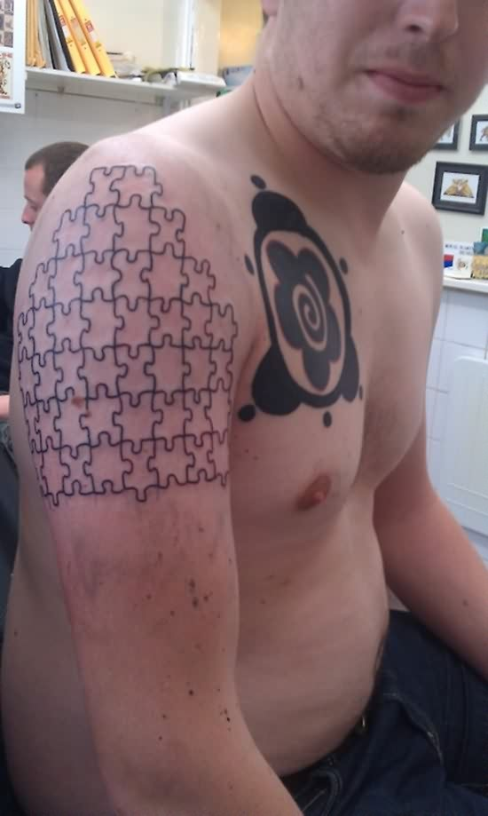 small-3d-puzzle-tattoos-on-right-shoulder