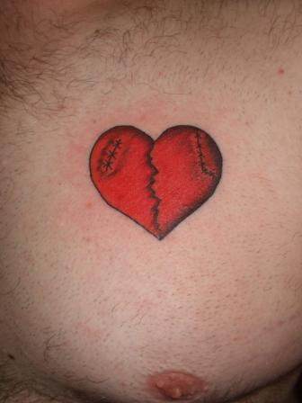 small-size-3d-broken-heart-tattoo-on-chest