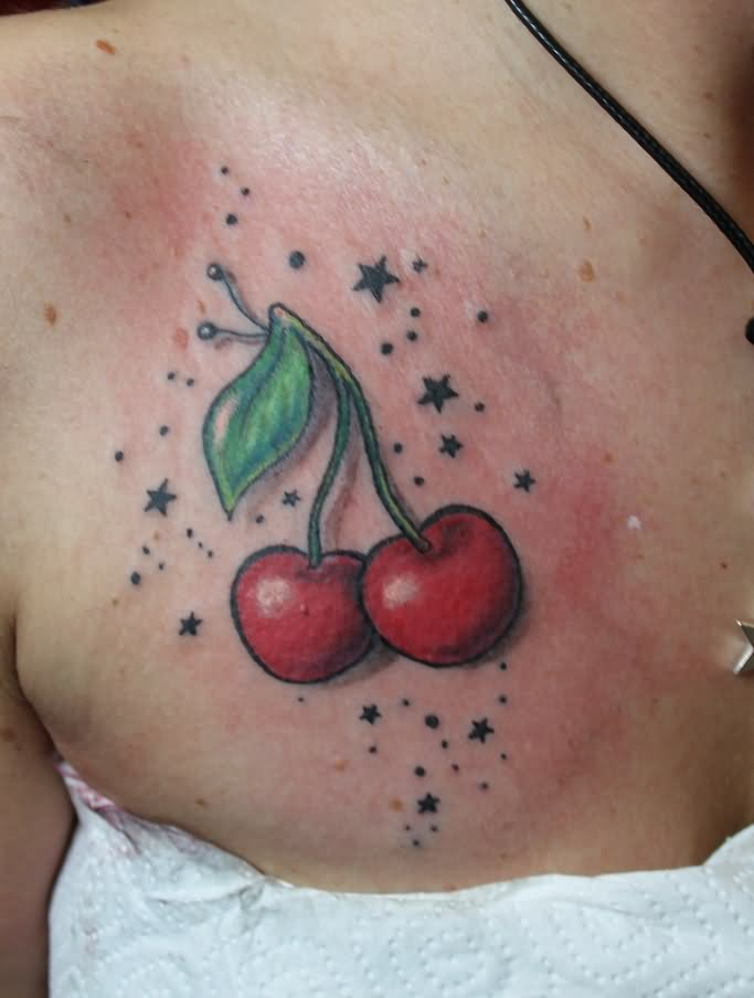 tiny-stars-around-3d-red-cherry-tattoos-on-chest