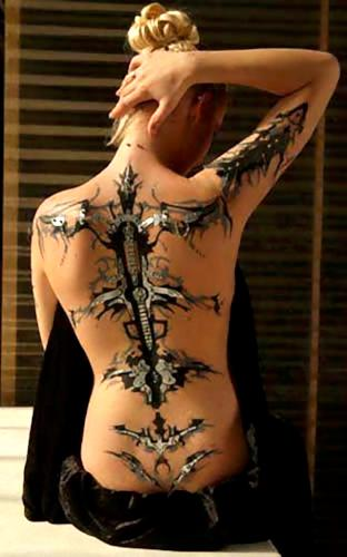 young-girl-with-3d-tattoos-on-back