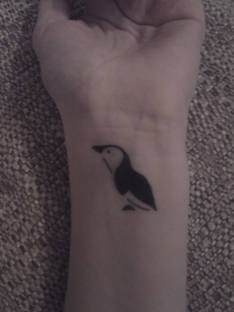 A Cute Penguin Tattoo On Wrist
