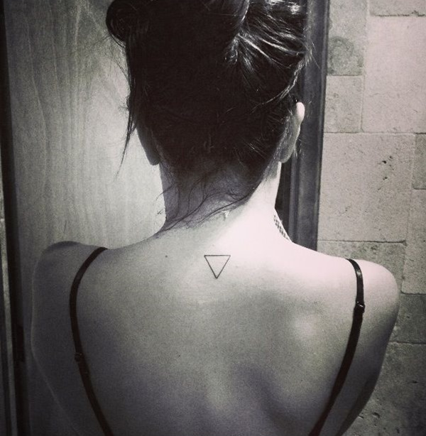 A Small Triangle Tattoo On Upperback