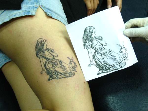 Alice In Wonderland Rabbit Tattoo On Thigh For Girls