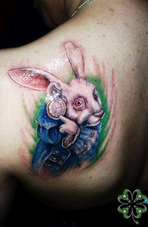 Alice Rabbit Tattoo On Back Shoulder For Women