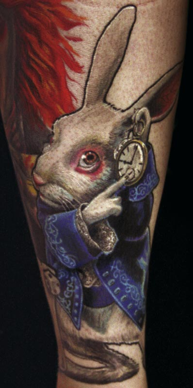 Aline In Wonderland Rabbit Tattoo On Arm