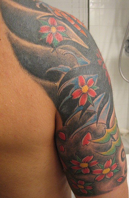 Amazing Asian Waves And Blossoms Tattoos On Sleeve