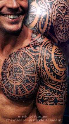 Amazing Black Polynesian Tattoos On Chest And Half Sleeve