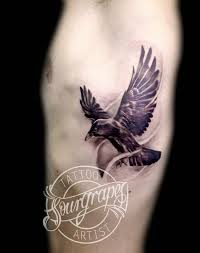 Amazing Flying Crow Tattoo On Side
