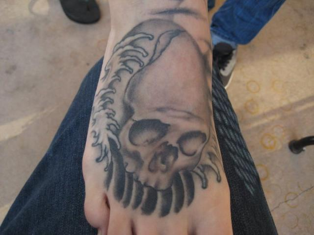 Amazing Grey Ink Skull Waves Tattoos On Foot