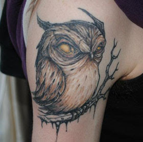 Amazing Horned Owl On Branch Tattoo