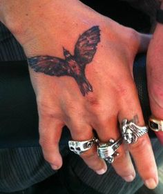 Amazing Small Flying Crow Tattoo On Hand