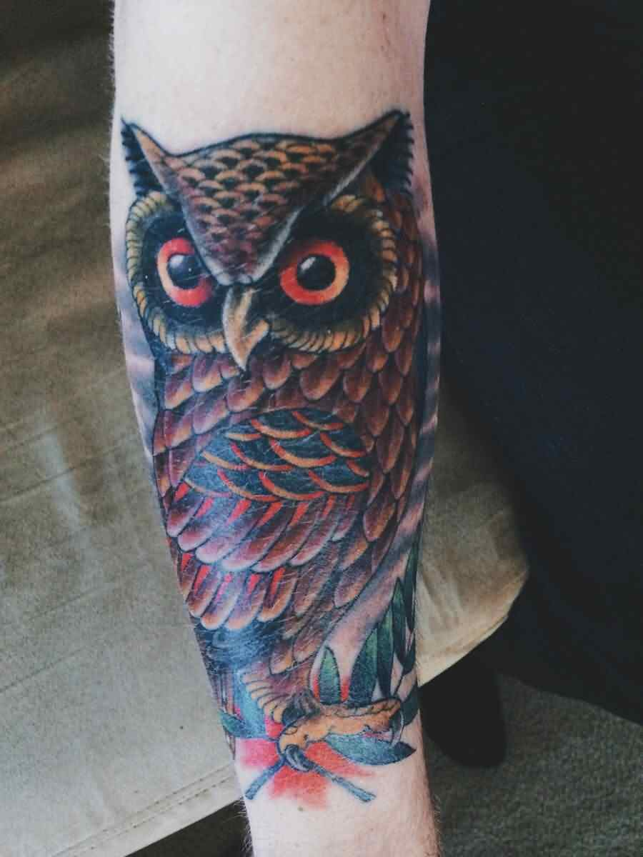 An Owl Tattoo On Arm