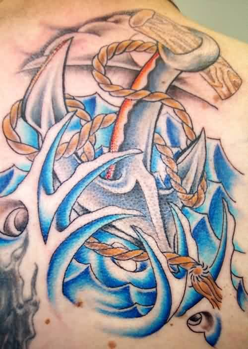 Anchor In Blue Waves Tattoos