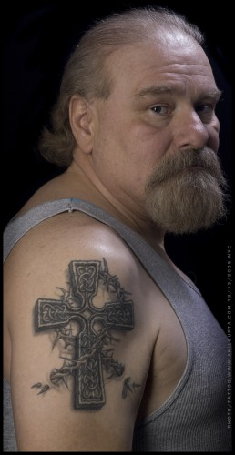 And Old Guy With 3D Celtic Cross Tattoo On Shoulder