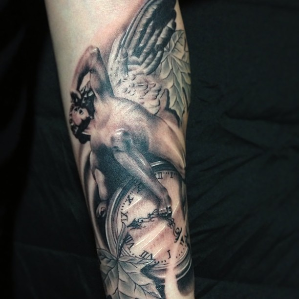 Angel On Clock Tattoo