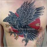 Arrows In Crow Tattoo On Chest