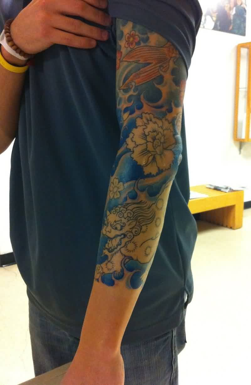 Asian Flowers And Blue Wave Tattoos On Sleeve