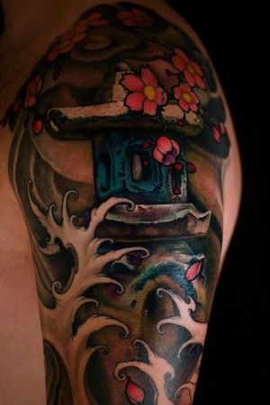 Asian Temple And Wave Tattoos On Shoulder