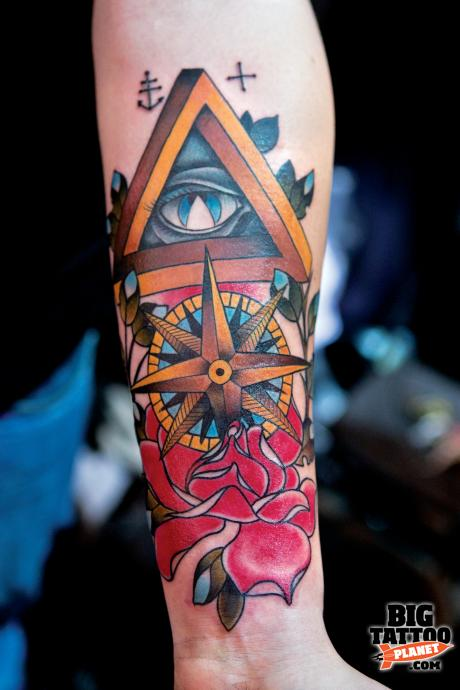 Attractive Eye Triangle Compass And Rose Tattoos On Lower Arm