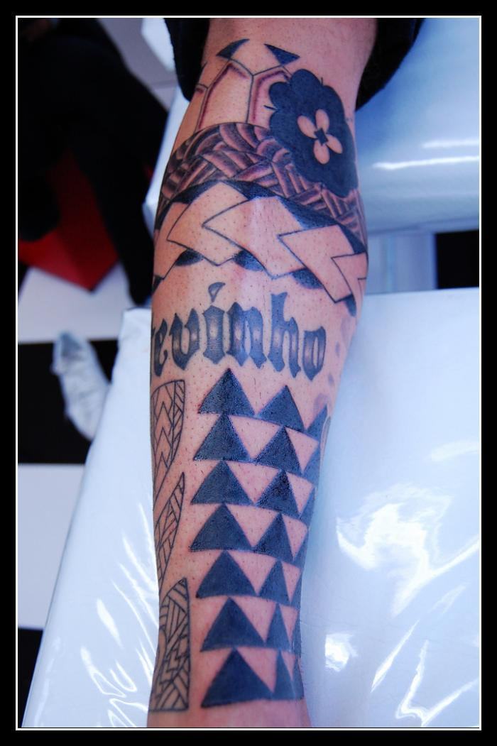 Awesome Black Ink Polynesian Triangle Tattoos