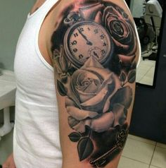 Awesome Clock And Rose Tattoos On Half Sleeve
