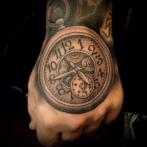 Awesome Grey Clock Tattoo On Hand