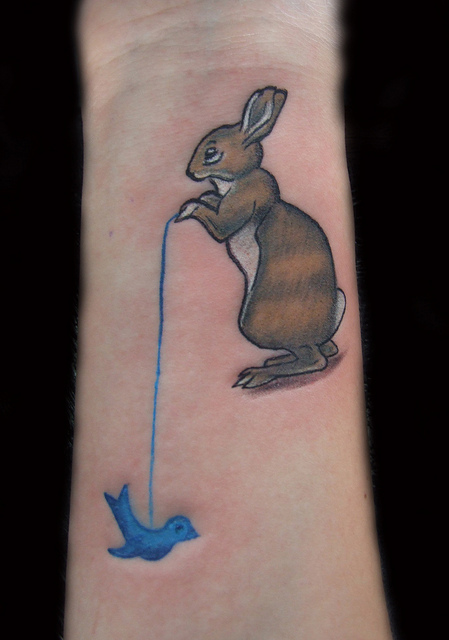 Awesome Rabbit With Bird Tattoos On Wrist