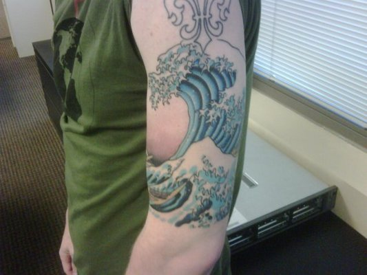 Awesome Sea Wave Tattoo On Arm