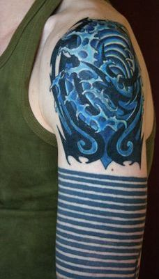 Awesome Tribal Waves Tattoos On Shoulder For Boys