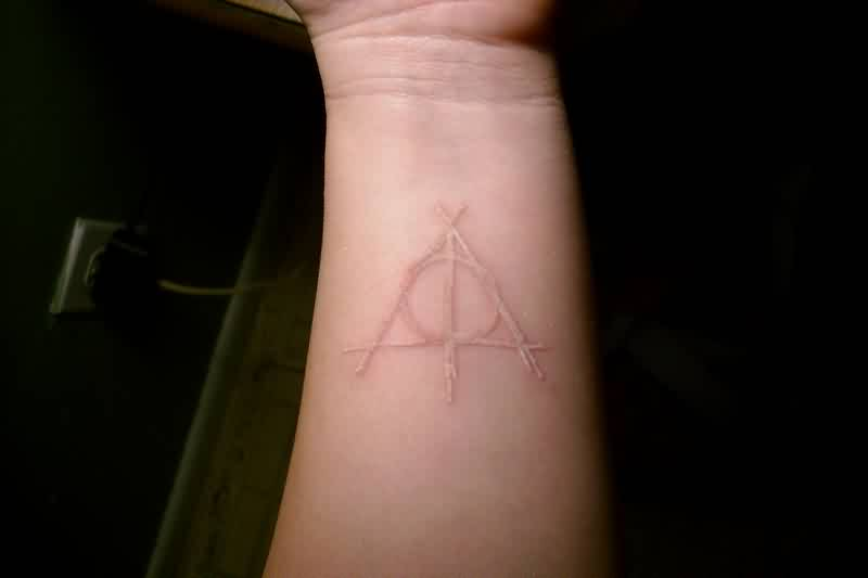 Awesome White Ink Triangle Tattoo On Wrist