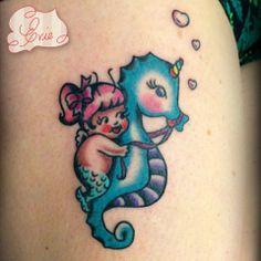 Baby Riding Blue Seahorse Tattoo