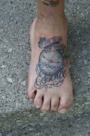 Banner Clock And Word Tattoos On Foot