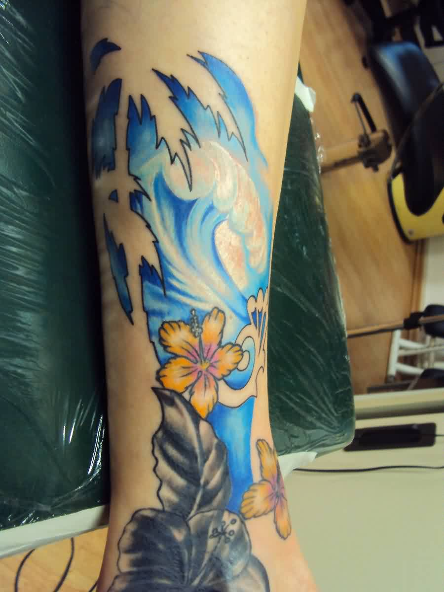 Beautiful Blue Wave And Flower Tattoos