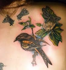 Beautiful Crow On Flower Branch Tattoo