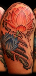 Beautiful Lotus And Wave Tattoos On Half Sleeve