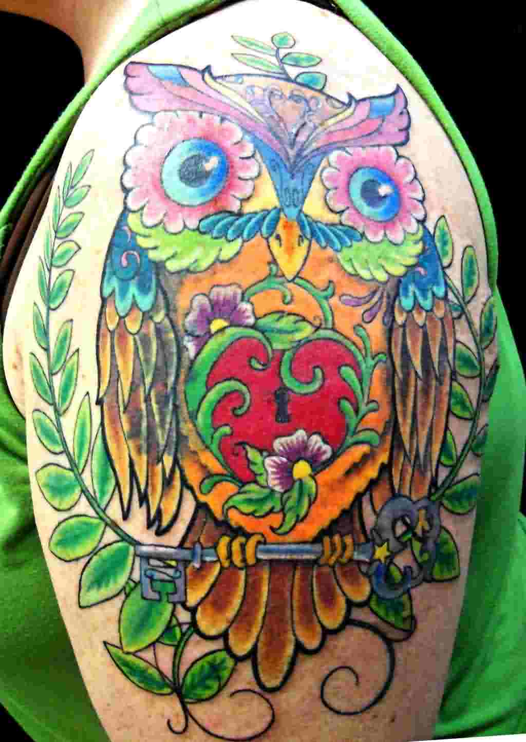 Beautiful Owl Sitting On Key Tattoo On Shoulder