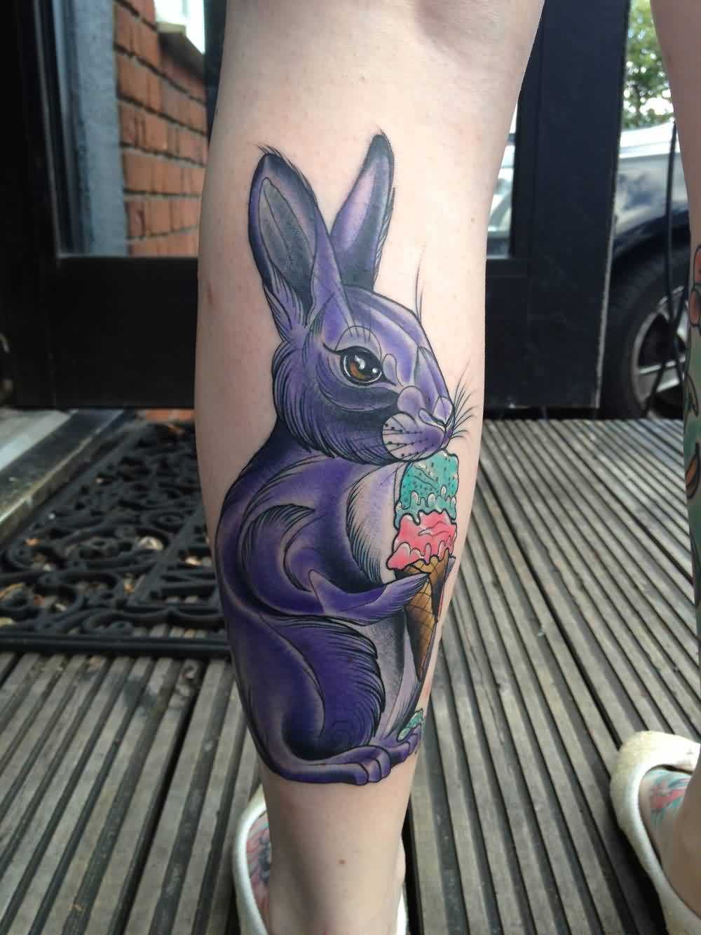 Beautiful Purple Rabbit With Ice Cream Tattoo On Leg