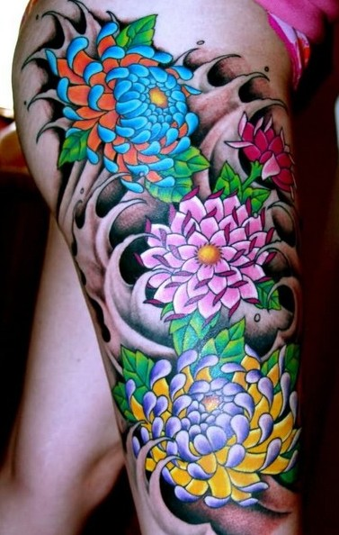Beautiful Waves With Flower Tattoos On Thigh