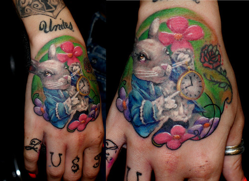 Beautiful White Rabbit With Flower Tattoos On Hand
