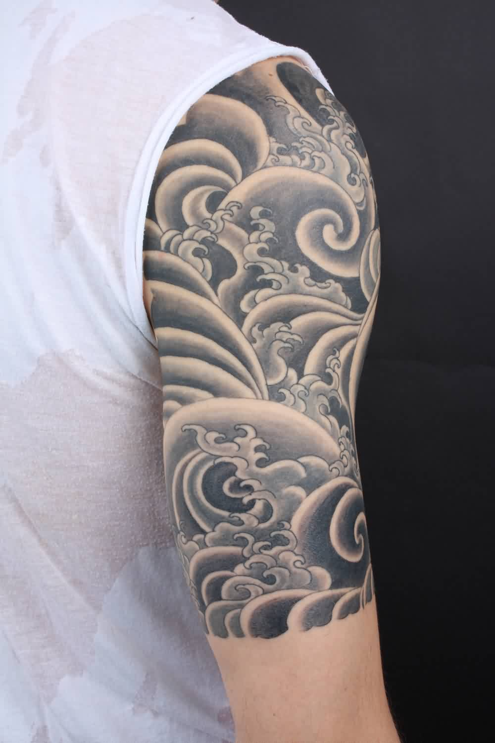 Black And Gray Tibetan Style Wave Tattoo On Half Sleeve