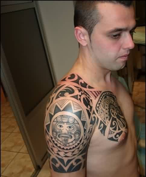 Black And Grey Ink Maori Polynesian Tattoos On Half Sleeve And Chest