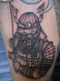 Black And Grey Ink Warrior Tattoo On Arm