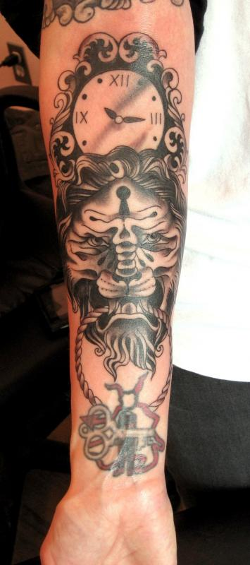 Black Clock And Lion Tattoos On Forearms