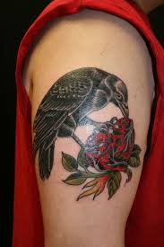 Black Crow Eating Heart Tattoo On Biceps