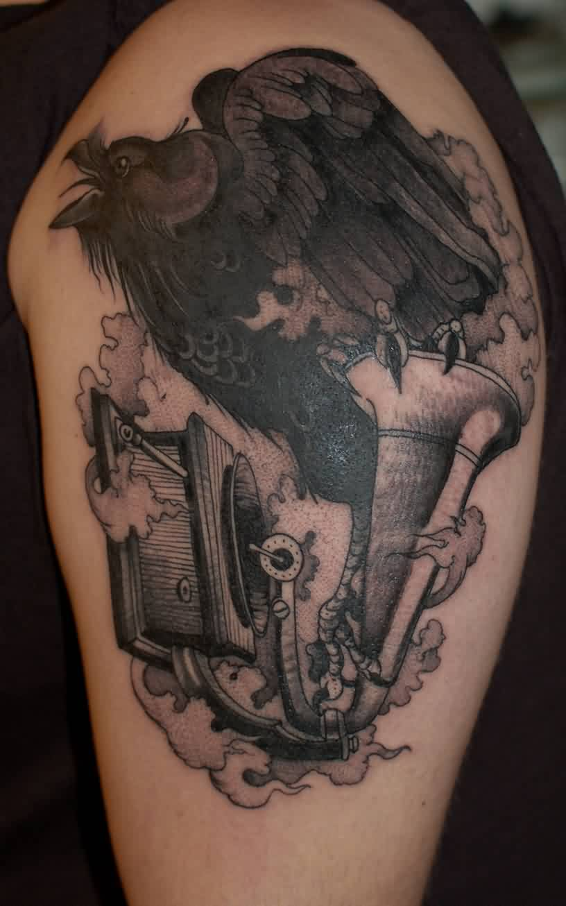 Black Crow Sitting On Music Instrument Tattoo