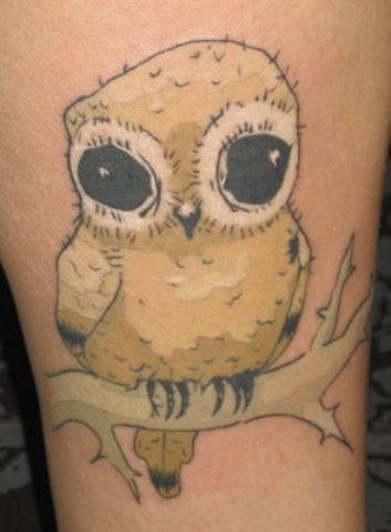 Black Eyed Owl On Branch Tattoo